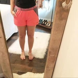 Under Armour large heatgear right coral gym shorts